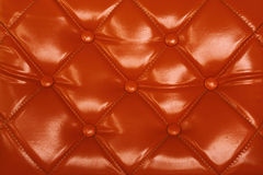 Orange velvet cushion Royalty Free Stock Photo