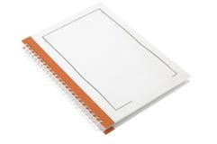 Orange Verkaufsunterlage-Anmerkungsbuch Lizenzfreie Stockfotos