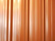 Orange vertikal stålbakgrund royaltyfria bilder