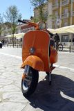 Orange Vespa. Parked on the sidewalk Royalty Free Stock Images