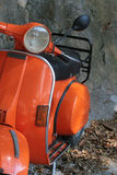 Orange vespa Stock Images