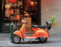 Orange Vespa motorbike  Stock Photos