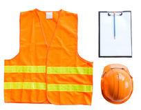 Orange vest. Hard hat with paper and pen put on white wooden table background royalty free stock images