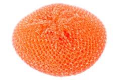 Orange vibrant plastic scourer. Isolated on white background Royalty Free Stock Photos