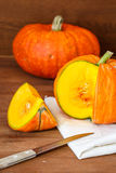Orange vibrant pumpkin with seeds Stock Photo