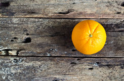 Orange vibrant on wooden table, vibrant concept Stock Photo