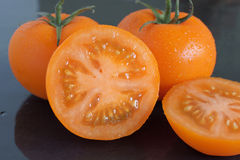 Orange vine tomatoes Stock Photos