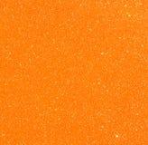 Orange vintage paper over bokeh glitter lights background Stock Image