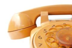 Orange vintage phone. On white background Royalty Free Stock Photo