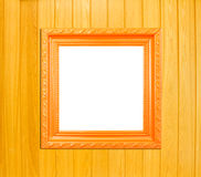 Orange Vintage picture frame on wood background Stock Photos