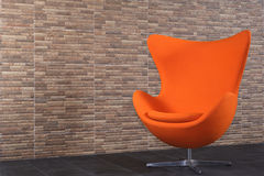 Orange vintage style recycled sofa in my room. Stock Photos