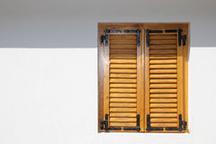 Orange vintage window with shutters Stock Photos