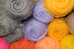 Orange, violet, gray and peach color wool. Many woolen yarn orange, violet, gray and peach color, soft texture stock photo