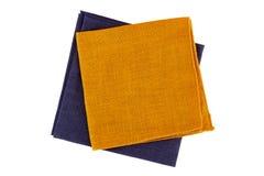 Orange and violet textile napkins on white Royalty Free Stock Image