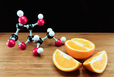 Orange and vitamin C structure model (Ascorbic acid) Royalty Free Stock Image