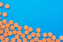 Orange vitamin pills Royalty Free Stock Image