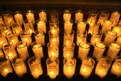 Orange votive candles. Rows of orange votive candles Stock Photo