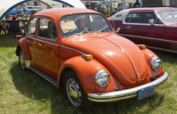 1971 Orange VW Beetle. IOLA, WI - JULY 13:  1971 Orange VW Beetle Car at Iola 41st Annual Car Show July 13, 2013 in Iola, Wisconsin Stock Photos
