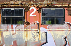 Orange waggon sprayed with graphic characters Stock Image