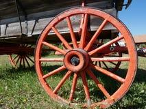 Orange wagon wheel. Antique Orange wagon wheel in grass royalty free stock photos