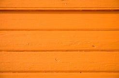 Orange wall. Close up of orange wooden trim Royalty Free Stock Photos