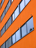 Orange wall. Closeup of a modern orange dormitory wall with windows in Tartu, Estonia Royalty Free Stock Images