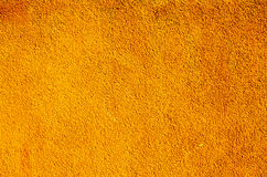 Orange wall. Bright orange wall of plaster stock image