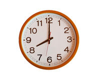 Orange wall clock isolated in eight o'clock. royalty free stock photo