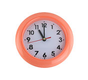 Orange wall clock isolated on white. Stock Photography