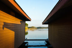 Orange wall of floating house and blue sky Royalty Free Stock Image