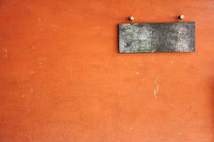 Orange wall with metal plate Stock Photos