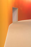 Orange wall and open entrance door in a empty room Royalty Free Stock Photos