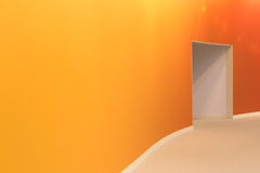 Orange wall and open entrance in a empty modern room Stock Image