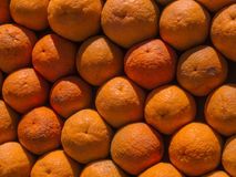 Orange wall. Pile of oranges from bodrum turkey, on a market stall. with the heat its hard to resist buying one to quench your thirst Stock Photos