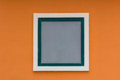 Orange wall and white  window Royalty Free Stock Images