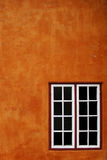 Orange wall and window Stock Images