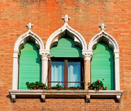 Orange wall and windows. Antique windows in a brick wall Royalty Free Stock Image