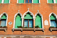 Orange wall and windows. Antique windows in a brick wall Royalty Free Stock Photos