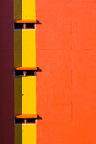 Orange wall and windows Stock Images