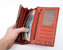 Orange wallet with money Stock Photo