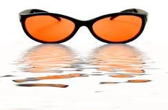 Orange Wasser-Gläser Lizenzfreie Stockfotografie