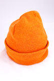 Orange Watch Cap. Against a white background Stock Photography
