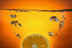 Orange in water Stock Images