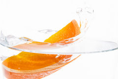 Orange and water. Orange in water and white background with drops Royalty Free Stock Photography