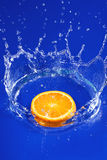 Orange in water Stock Image