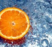 Orange in water Stock Image