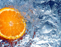 Orange in water Stock Photo