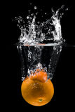 Orange in water. Over black Royalty Free Stock Photos