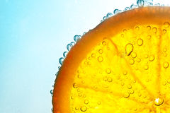 Orange in water bubbles Stock Photo