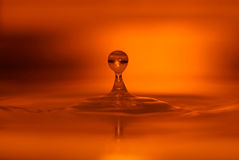 Orange water drop Royalty Free Stock Images